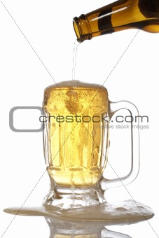 Pouring beer into mug