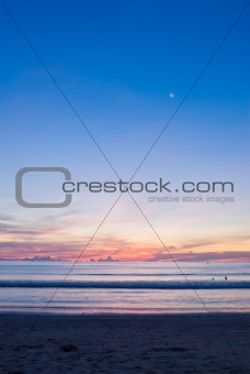 beach sunset with a half-moon