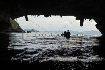 sea canoe over cave