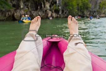 tourist legs at sea canoe
