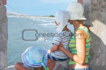 family looking on surfing