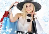 portrait of blonde in hat with shopping bags