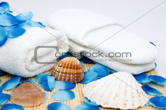 Towel and slippers for spa with sea shells
