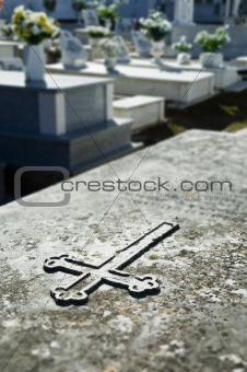 Cross engraved in a tombstone