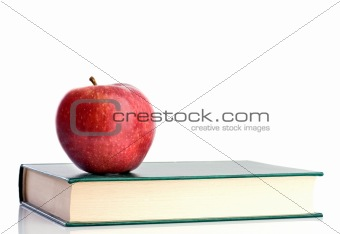 A red apple red on a green paper