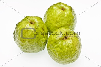 three guavas on a white background