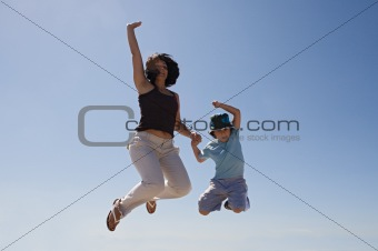 Mother and son jumping