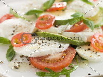 Tomato Avocado and Mozzarella Salad with Olive Oil and Black Pep