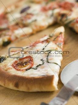 Slice of Tomato Mozzarella Aubergine and Basil Pizza