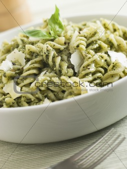 Bowl of Fusilli Pasta dressed in Pesto with Parmesan Shaves