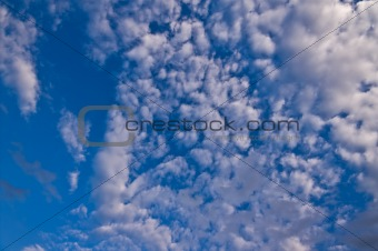a lot of fluffy clouds in the sky with a little bit of blue sky visible
