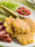 Sweet corn Fritters with Salsa Gherkins Avocado and Pastrami
