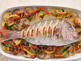Whole Roasted Bream with Chilies Potatoes and Peppers