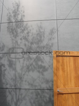 grey concrete wall and wooden door