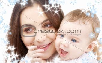 smiling baby in mother hands