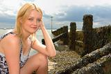 Cute young blond lady at breakwater
