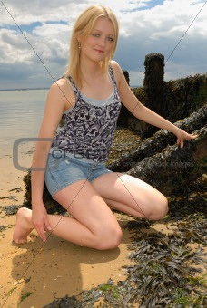 Cute young blond lady on beach