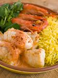 Saute of Monkfish Prawns and Rice with Pimento Cream