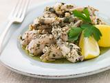 Frogs Legs Fried in Garlic and Herb Butter with Lemon