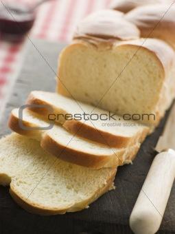Brioche Loaf Sliced on a Chopping Board
