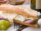 Brie and Ham Baguette with White Wine and Grapes