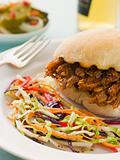 Pulled Pork and Barbeque Sauce Roll with Seeded Slaw and Gherkin