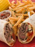 Philly Beef Steak Wrap with Fries Tomato Salsa and Corn