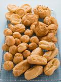 Selection of Choux Pastry Buns on a Cooling Rack