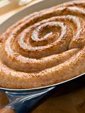 Cumberland Sausage Coil in a Frying Pan