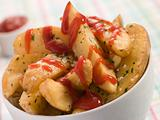 Bowl of Potato Wedges and Tomato Ketchup