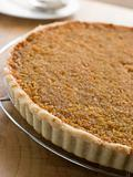 Whole Treacle Tart on a Cooling Rack