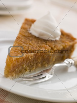 Slice of Treacle Tart with Whipped Cream