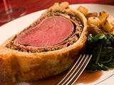 Slice of Beef Wellington with Spinach and Saut ed Potatoes