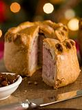 Pork Pie cut on a Board with Chutney