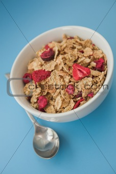 Cereal & fruits on a blue background