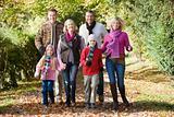 Multi-generation family on walk through woods