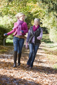 Mother and daughter on walk through woods