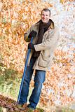 Man tidying autumn leaves