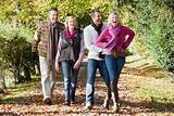 Family group walking through woods