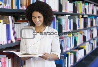 Woman reading in a library