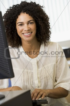 Mid adult woman working on a computer