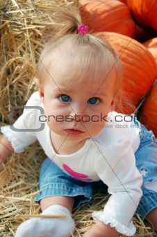 Baby with Pumpkins