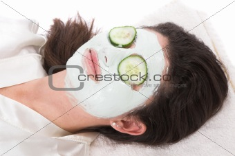 Woman taking a claymask