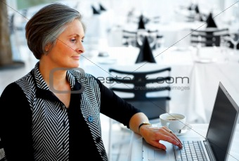 Older Businesswoman with Coffee and Internet