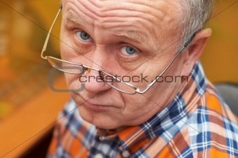 Casual senior man with glasses. Emotional portrait series.