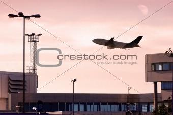 cargo jet taking off at dusk.