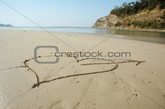 Heart with arrow on a beach