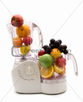 kitchen machine and fruits on white background