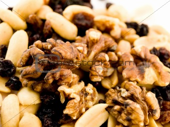 Close Up Walnuts Peanuts and Dried Fruit on White Background