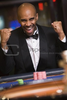 Man winning at roulette table